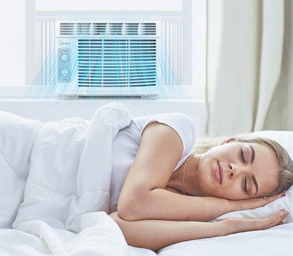 tiny midea air conditioner installed in a small room