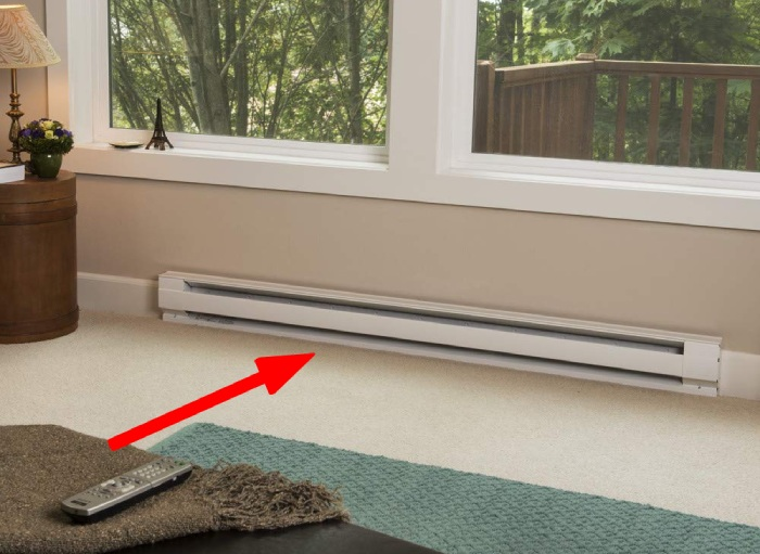 baseboard heater installed under the window to eliminate cold drafts